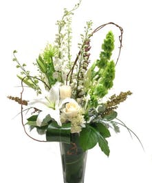 Vased arrangement of white and green flowers.