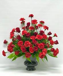 All-red funeral flower arrangement.