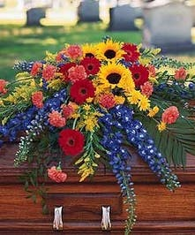 A lovely casket piece with bright summer flowers