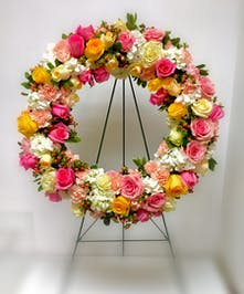 Sympathy wreath of all roses in soft colors.