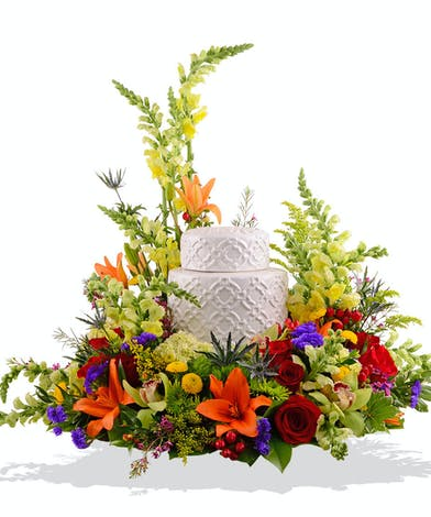 Urn wreath of roses, greenery and more.