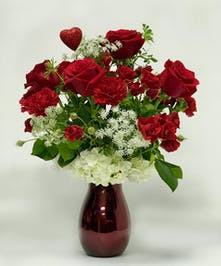 A beautiful design of red roses and red carnations.