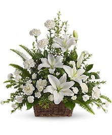 Sympathy basket of all-white flowers.