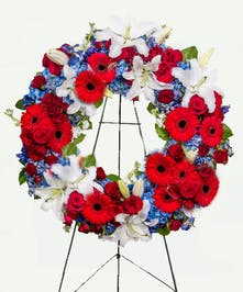 Wreath of red, white and blue flowers for a patriotic tribute.